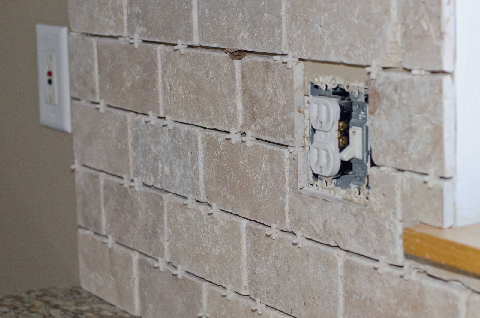 The best way to install wall tile around outlets f r i n for How to install backsplash around outlets